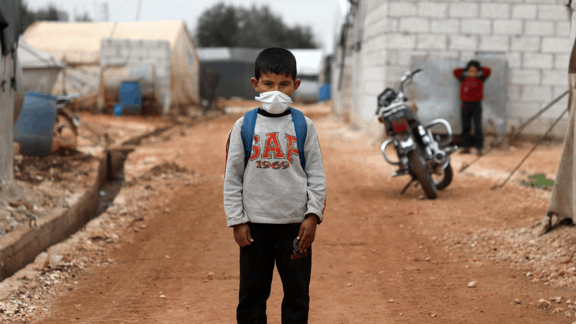 Boy in refugee camp with face mask